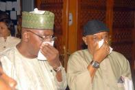 Senators Chris Ngige and Danjuma Goje choking on the teargas the police used on the Speaker.