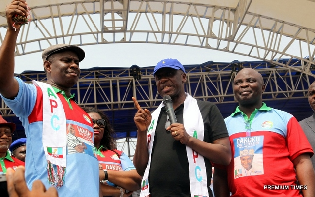 Rivers State Governor, Chibuike Rotimi Amaechi flanked by the All Progressives Congress Governorship Candidate in the State, Dakuku Peterside (left) and his running mate, Asita, at the State APC 2015 gubernatorial campaign flag off at the Liberation Stadium, Port Harcourt.)