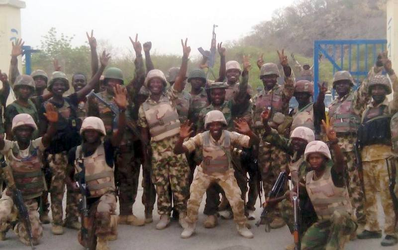 Nigerian Soldiers jubilating after a battle with Boko Haram
