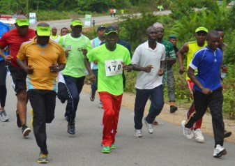 Governor Adams Oshiomhole leads others at the 3rd edition of the Annual IAAF certified 10km Okpekpe race, on Saturday.
