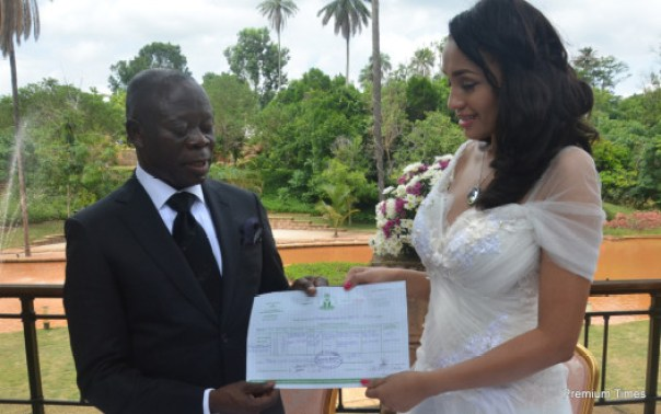 Mr and Mrs Adams Oshiomhole display their wedding certificate.