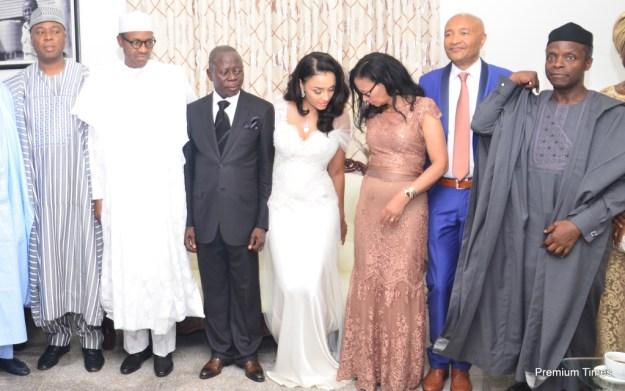 From left: Senator Bukola Saraki, President-elect, Muhammadu Buhari; Governor Adams Oshiomhole; his wife, Iara Oshiomhole, Mrs and Mrs Fortes, parents of the bride and Vice President-elect, Prof Yemi Osibanjo.
