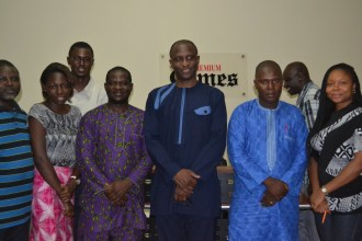 Mr Akande in a group photo with staff of Premium Times