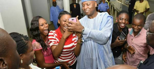 Senate President, Bukola Saraki, in selfie-time with young Nigerians working in the National Assembly