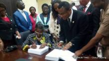 1-Prof Comfort Ekpo and the new Uniuyo VC, Prof Enefiok  Essien sign hand over notes