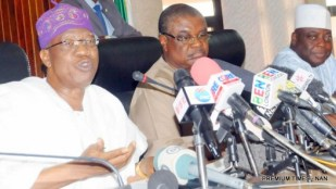 FILE PHOTO: Minister of Information and Culture, Alhaji Lai Mohammed (L), Addressing a World News Conference in Abuja on Tuesday (8/12/15), on the Security Situation in the North-East. With him is the Director of Public Communications, Mr Emmanuel Agbegir (M) and Director of Protocol and Public Relations, Mr Peter Dama