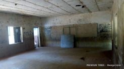 A classroom at Government Junior Secondary School, Fagoji-Dutse, where students sit on the bare floor to learn
