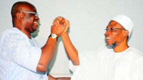 Governor State of Osun, Ogbeni Rauf Aregbesola and his Ekiti State counterpart, Mr. Ayodele Fayose, during a visit by Governor Fayose, at the Government House, Osogbo