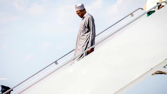 President Muhammadu Buhari alighting from the plane on one of his trips