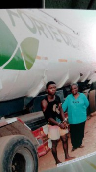 Two of the suspects with the truck containing the fuel