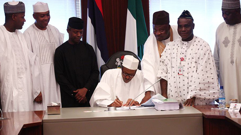 President Buhari signing the budget
