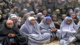 "A screengrab taken on May 12, 2014, from a video of Nigerian Islamist extremist group Boko Haram obtained by AFP shows girls, wearing the full-length hijab and praying in an undisclosed rural location. Boko Haram released a new video on claiming to show the missing Nigerian schoolgirls, alleging they had converted to Islam and would not be released until all militant prisoners were freed. A total of 276 girls were abducted on April 14 from the northeastern town of Chibok, in Borno state, which has a sizeable Christian community. Some 223 are still missing. AFP PHOTO / BOKO HARAM RESTRICTED TO EDITORIAL USE - MANDATORY CREDIT ""AFP PHOTO / BOKO HARAM"" - NO MARKETING NO ADVERTISING CAMPAIGNS - DISTRIBUTED AS A SERVICE TO CLIENTS"