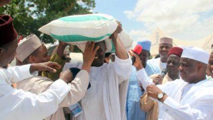 Presenting fertilizer to a farmer.