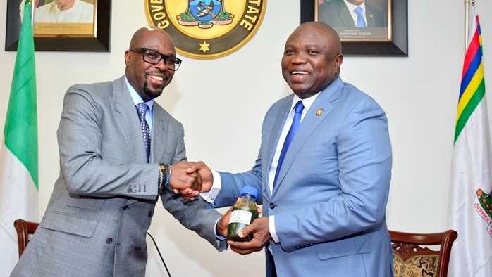 Lagos State Governor, Mr. Akinwunmi Ambode (right), receiving a sample of the Crude Oil discovered in the State by the Group Managing Director, Tunde Folawiyo Petroleum Company Limited, Mr. Tunde Folawiyo  Photo: Lagos State government