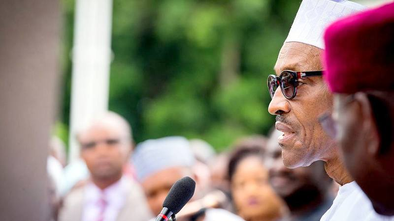 FILE PHOTO: President Muhammadu Buhari briefing Members of Staff of the Statehouse at the Presidential Villa