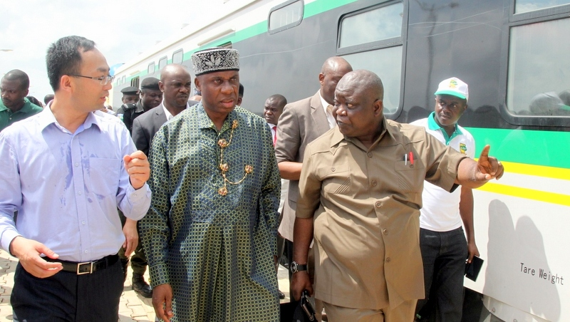 Minister of Transportation Chibuike Rotimi Amaechi, (middle) with the Managing Director, China Civil Engineering Construction Corporation Ltd. (CCECC) Jack Li (left) and Mr Fidel Okhiria, Acting Managing Director of the Nigerian Railway Corporation.(right) during the test run of the recently built Rail line from Abuja (Idu) to Kaduna