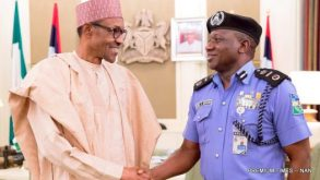 FILE PHOTO: President Muhammadu Buhari (L) in a handshake with the new Acting IGP, IBRAHIM IDRIS, during a visit to the Presidential Villa in Abuja on Tuesday (21/6/16) 4523/21/6/2016/ICE/HB/NAN