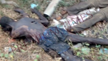 burnt corpses in borrow pit.bmp