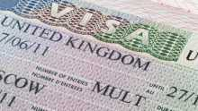 Close up United Kingdom visa in passport used to illustrate the story