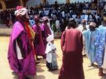 A young boy being accompanied by men at the Bauchi Sallah Durbar