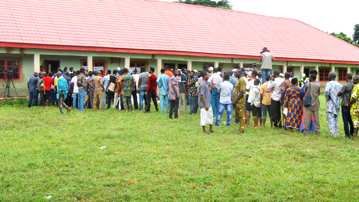 FILE PHOTO: Voters queuing to vote at the Edo election
