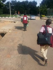 Yaro boys helping students carry their luggage to their hostels