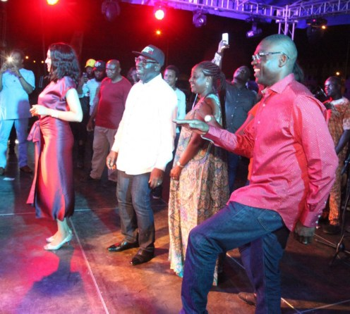 Mr Philip Shaibu, Deputy-Governor-elect (right), and others dance to a tune at the victory party.