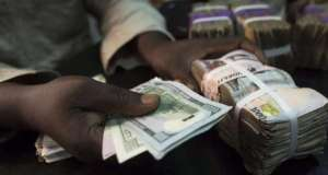 Dollar and Naira bills [Photo credit: NairaFX]