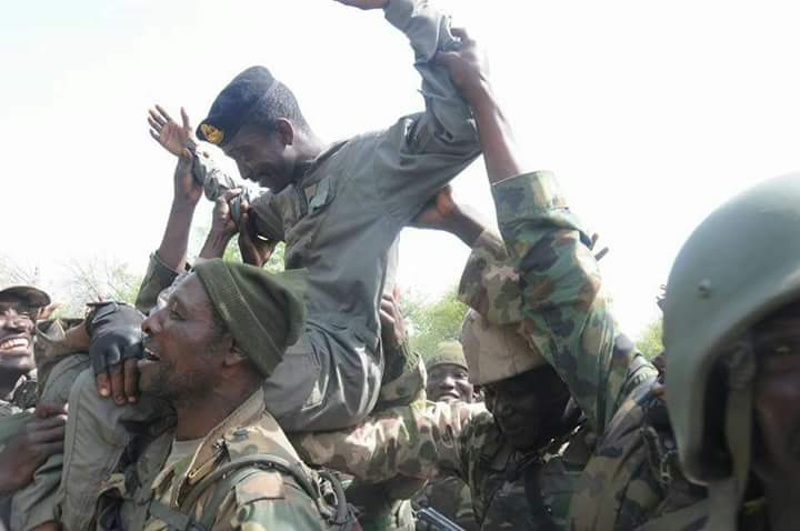 Lt. Col. Abu Ali lifted high by troops after he helped in capturing a location in the North-East.