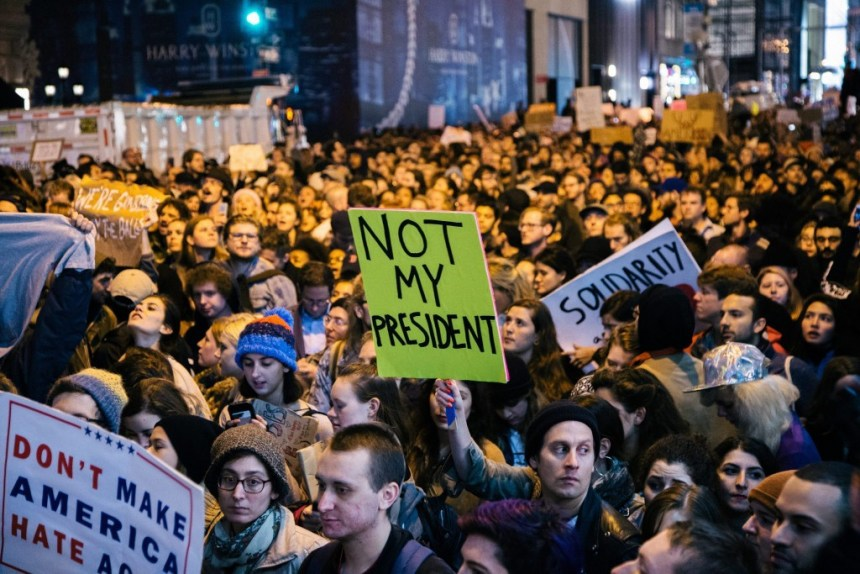 People protest the presidential election results in New York. Protesters filled 5th Avenue for five blocks, essentially closing down part of midtown Manhattan. (Alba Vigaray / European Pressphoto Agency)