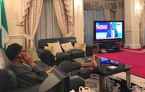President Muhammadu Buhari watching TV