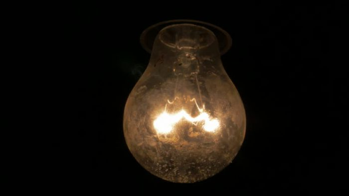 Bulb in the dark used to tell the story.