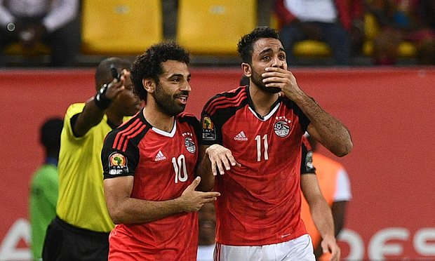 Karahba (right) celebrates his late winner with team-mate Mohamed Salah. [Photo credit: theguardian.com   Photograph: Justin Tallis/AFP/Getty Images
