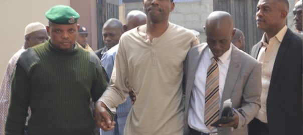 FORMER MEMBER OF HOUSE OF REPRESENTATIVES, NZE CHIDI DURU BEING LED TO COURT BY SECURITY AGENTS OVER ALLEGATIONS OF STEALING, CONSPIRACY, IMPERSONATION, AND BREACH OF PEACE