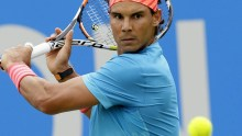 Spain's Rafael Nadal plays a return shot to Ukraine???s Alexandr Dolgopolov during their men's singles tennis match at Queen's tennis championship in London, Tuesday June 16, 2015. (AP Photo/Tim Ireland)