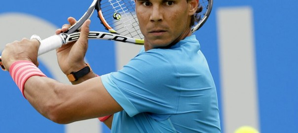 Spain???s Rafael Nadal plays a return shot to Ukraine???s Alexandr Dolgopolov during their men's singles tennis match at Queen's tennis championship in London, Tuesday June 16, 2015. (AP Photo/Tim Ireland)