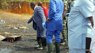 The Hon. Minister of Health, Prof. Isaac Adewole,behind the minister is Hon. Chike Obi ,Inspecting the seized fake drugs at NAFADAC dump site in Port Harcourt,Rivers state.