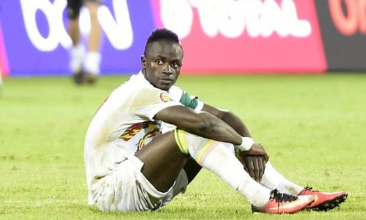 Sadio Mané looks dejected after his penalty shoot-out miss means that Senegal were knocked out of the African Cup of Nations. Photograph: Khaled Desouki/AFP/Getty Images
