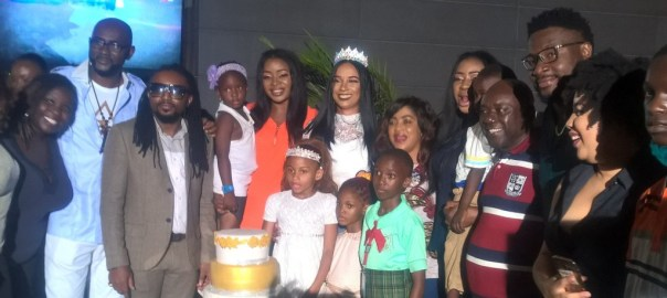 Ibinabo flanked by colleagues and beneficiaries of a scholarship she finances, at her birthday party on Friday night in Lagos.