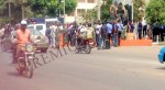 Protesters, police argue at the gate of the governor's office in Akure
