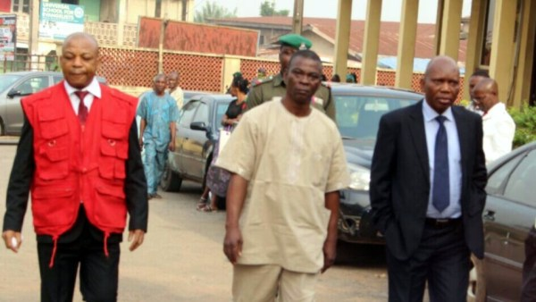 FUTA VC, Prof. Gregory Daramola (right) and Burser, Oresegun arriving the court premises on Tuesday in Akure