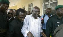 FILE PHOTO: Former Army chief General Ishaya Bamaiyi (C) is led out of the courtroom after regaining his freedom of attempted murder charge at the Ikeja High Court in Lagos on April 3, 2008. A Lagos high court has discharged and acquitted General Bamaiyi, former Army Chief during the dictatorial regime of General Sani Abacha, who has been standing trial on four counts of attempted murder since 1999.  AFP PHOTO/PIUS UTOMI EKPEI (Photo credit should read PIUS UTOMI EKPEI/AFP/Getty Images)