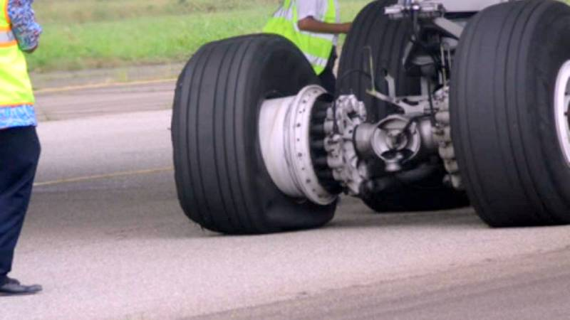 The burst Tyre of the Aircraft as it crash lands in Lagos Airport