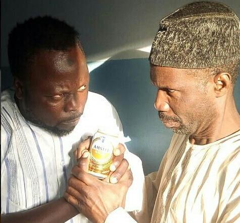Tijjani Asase and his friend holding Amstel malta in Zango's contest