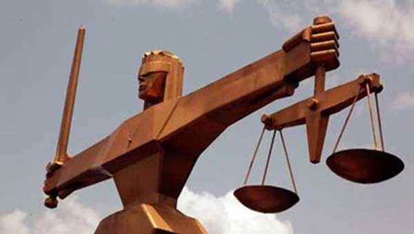 Duped depositors of fraudulent banking scheme protest in court