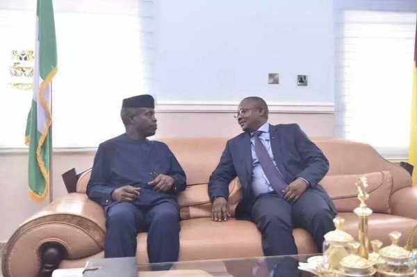 Acting President Yemi Osinbajo (L) and Omaru Sissco Embalo (L)