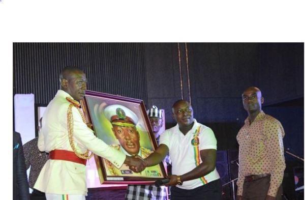 Babachir Lawal receiving award at Peace Corps' 18th anniversary