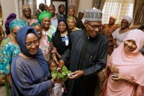 President Buhari joins family members. Wife, Aisha (L) and daughter, Zahra, (R) and other well wishers at the Presidential Villa on Friday.