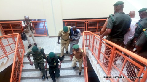 Apo Six: Police officers being led by Prison officials