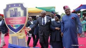 L-R: Lagos State Governor, Mr. Akinwunmi Ambode; Deputy Governor, Dr. (Mrs) Oluranti Adebule and Speaker, Lagos State House of Assembly, Rt. Hon. Mudashiru Obasa, with the newly unveiled Neighbourhood Safety Corps logo during the inauguration of the Corp at the Agege Mini Stadium, Lagos, on Monday, March 27, 2017.